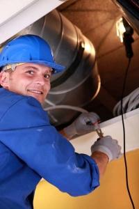 man repairing HVAC system