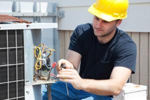 man installing air conditioning unit