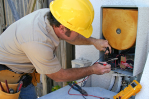 An air conditioning tech working on a heat recovery unit.